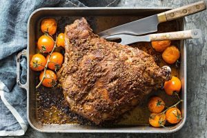 , Orange and Cumin Leg of Lamb with Roasted Tomatoes and Garlic